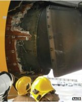 One of the Boeing 777's engine thrust reversers was damaged